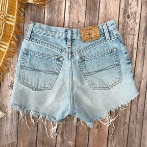 Vintage High Waist Light wash denim cut off shorts
